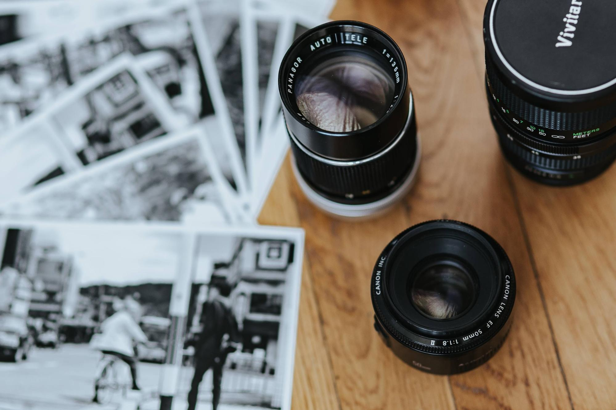 Video shooting lenses and photos on a wooden table