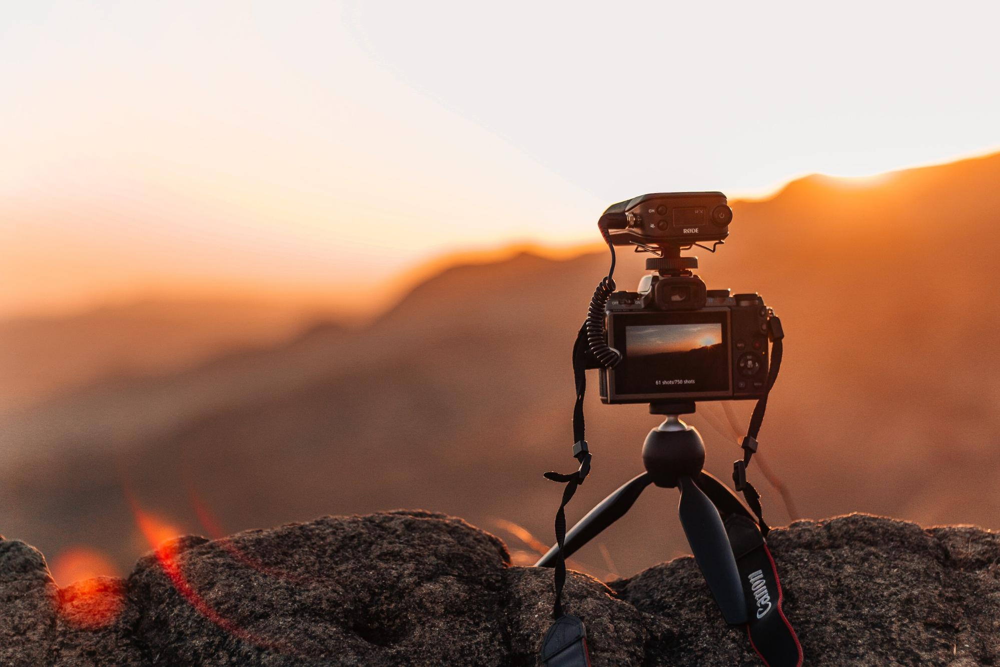 Camera on mini tripod recording sunset