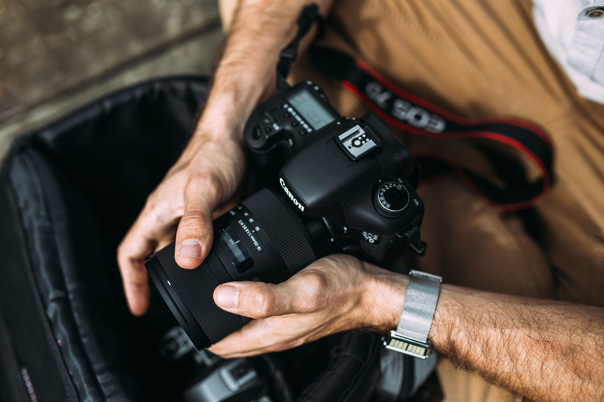 Video camera equipment in male hands